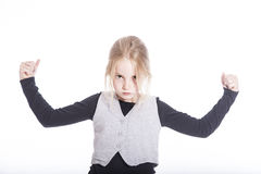 Young blond girl with confident attitude in studio Royalty Free Stock Photo