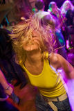Young blond girl on the dancefloor Royalty Free Stock Image