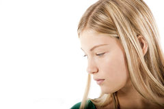 Young blond girl in deep thought. Copy-space Stock Photography