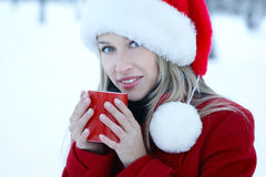 A young blond girl is drinking hot coffee Stock Photos