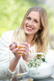 Young Blond Girl Drinking Tea Stock Photography