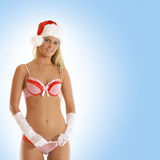 A young blond girl in erotic Christmas lingerie Royalty Free Stock Images