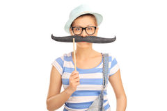Young blond girl with fake mustache Stock Images