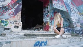 Young blond girl freak posing at the camera. Slow-motion shooting stock footage