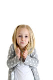 Young blond girl with funny expression shrugging shoulders Royalty Free Stock Image