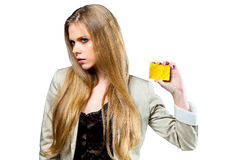 Young blond girl with golden card Stock Image