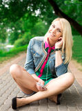 Young blond girl listening music Stock Photography