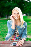 Young blond girl listening player Stock Images