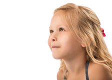 Young blond girl looking up. A young, blond girl looking up, isolated on a white background Royalty Free Stock Photos