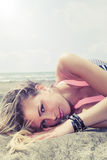 Young blonde hair girl lying in the sea Royalty Free Stock Images