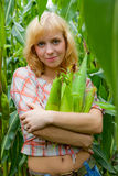 Young blond girl with maize Stock Photography