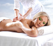 A young blond girl on a massage procedure Royalty Free Stock Images