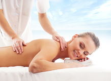 A young blond girl on a massage procedure Royalty Free Stock Photography