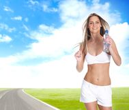 A young blond girl is running on the freeway Royalty Free Stock Images