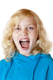Young blond girl screams loudly at camera. Isolated on white background Stock Photo