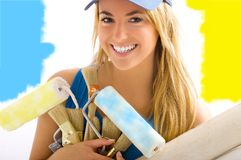 Young blond girl smiling. Young blond girl with blue and yellow paint Stock Photos