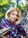 Young blond girl talking on the phone Stock Photography