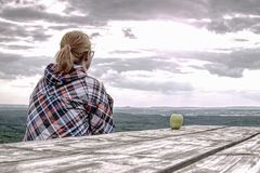 Young blond girl trekker resting at wooden table royalty free stock photos