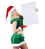 Young blond girl wearing santa claus clothes Stock Photo