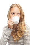 Young blond girl with white cup Royalty Free Stock Photography
