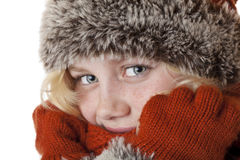 Young blond girl with winter cap and gloves. Isolated on white background Stock Photos