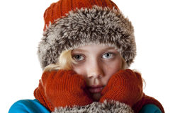 Young blond girl with winter cap and gloves. Is cold.Isolated on white background Royalty Free Stock Image