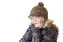 Young blond girl with winter cap and jacket Royalty Free Stock Images