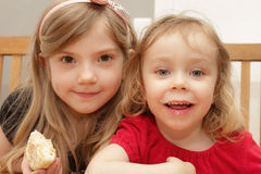 Young blond girls eating Royalty Free Stock Photo