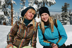 Young blond girls in winter clothes Stock Photos