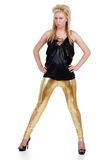 Young blond with gold pants and attitude. Isolated young blond with gold pants and attitude on a white background stock photography