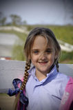 Young blond hair girl with long braids royalty free stock photo