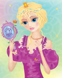 Young blond hair princess. With mirror in her hands Royalty Free Stock Images