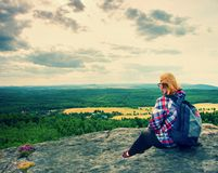 Young blond hair Woman hiker takes a rest on peak of the Mountain Royalty Free Stock Photography