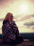 Young blond hair Woman hiker takes a rest on peak of the Mountain Royalty Free Stock Images