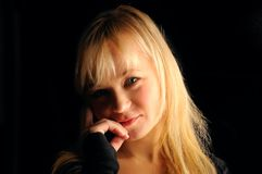 Young blond hair woman portrait  on dark background Royalty Free Stock Photos