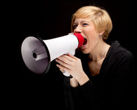 Young blond hair woman with white megaphone Royalty Free Stock Images