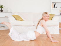 Young blond-haired woman doing fitness exercises Royalty Free Stock Photography