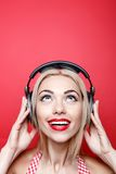 Young blond-haired woman with headphones Royalty Free Stock Photo