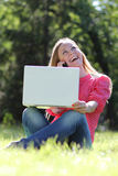 Young blond having fun with laptop Stock Photos