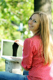 Young blond having fun with laptop Royalty Free Stock Image