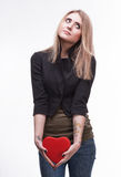 Young blond with a heart Royalty Free Stock Image