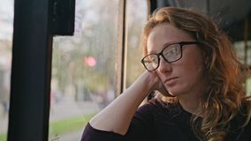 Young Blond Lady on the Bus. A young blond lady on the bus. Close-up shot stock footage