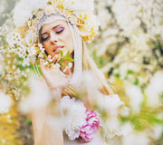 Young blond lady in the fragrant garden Stock Image