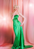 Young blond lady posing. Beautiful girl in a green dress Stock Photo