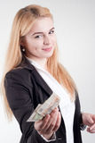 Young blond long-haired woman holding banknotes Royalty Free Stock Images