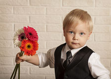 Young blond man in with bouquet flowers. Stock Image