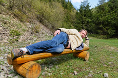 Young blond man laying on his side Royalty Free Stock Photos