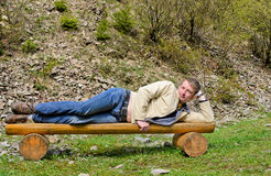 Young blond man laying on his side Stock Photography