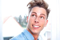 Young blond man smiling Royalty Free Stock Photos