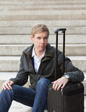 Young blond man with suitcase royalty free stock images